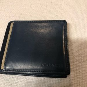 Blue leather coach wallet with insert.